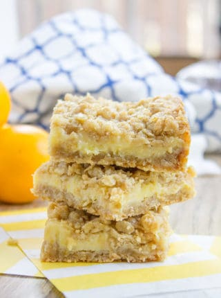 Easy Creamy Lemon Crumb Bars with a quick oatmeal crumb base and a sweet and tart creamy lemon filling.