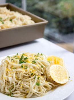 Creamy Parmesan Lemon Baked Pasta made with just 5 ingredients (plus salt, pepper and olive oil)! Crispy on top and creamy inside with fresh lemon juice and lemon zest on top. dinnerthendessert.com