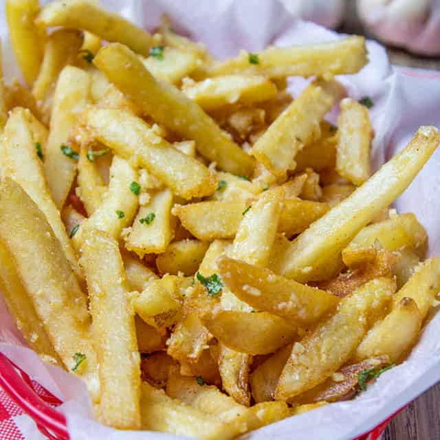 Oven Baked French Fries tossed in slightly warmed chopped garlic, olive oil and kosher salt, just like you enjoy at the ball game!