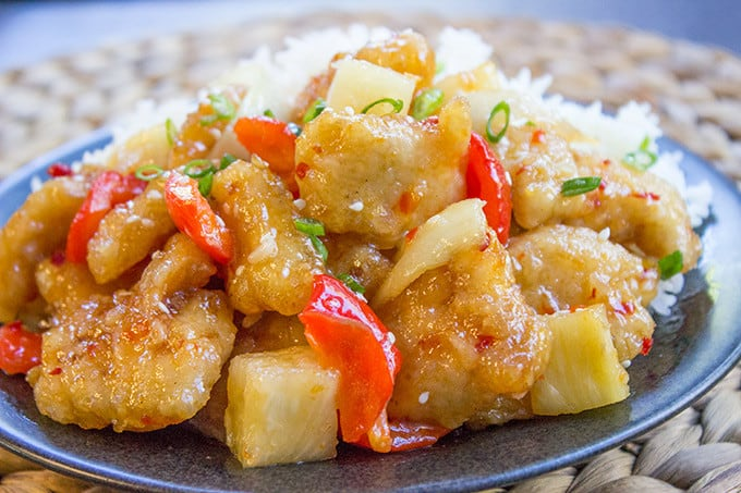 This copycat Panda Express Sweetfire Chicken Breast dish is made with crispy chicken with garlic, red bell peppers, onions and pineapples in a sweet and spicy chili sauce. A spot on copy!