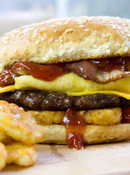 Carl's Jr. Breakfast Burger with seared beef patty, crispy hash browns, scrambled eggs, cheese and glorious bacon. All the flavor, no drive-thru.