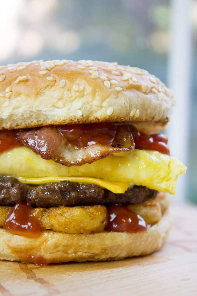 Carl's Jr. Breakfast Burger with seared beef patty, crispy hash browns, scrambled eggs, cheese and glorious bacon. All the flavor, no drive through.
