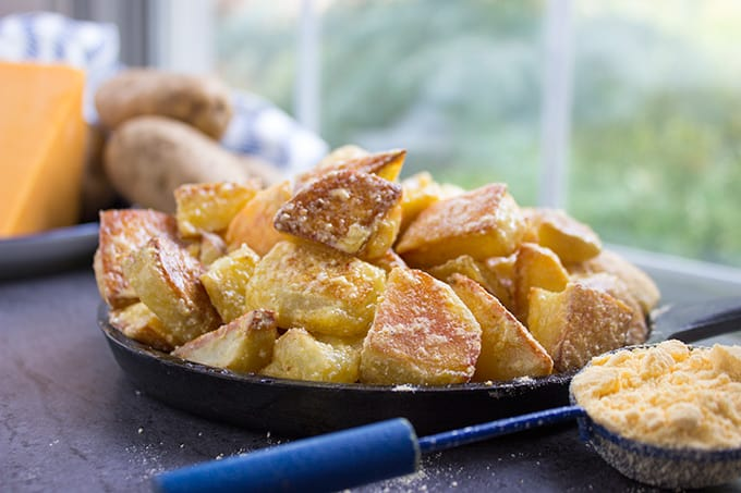 Cheddar and Sour Cream Roasted Potatoes have all the flavors of Cheddar and Sour Cream Potato Chips on freshly roasted potatoes! Made with 100% natural powdered cheddar and sour cream and totally craveable!