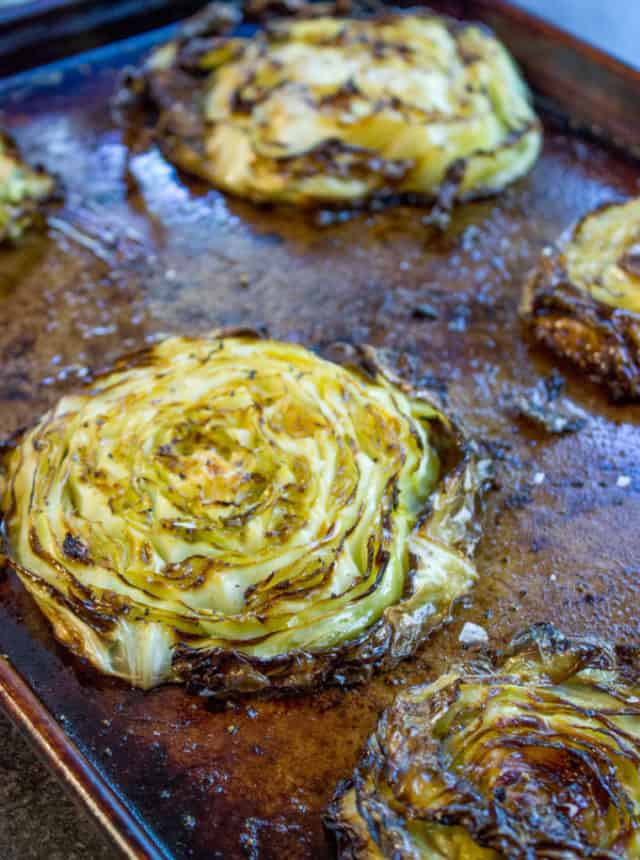 Crispy Roasted Cabbage Steaks make a great side dish for any meal (not just your favorite Corned Beef) in just 20 minutes. You'll never boil cabbage again.