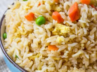 Classic Fried Rice takes just ten minutes to make with day old steamed rice, soy sauce, eggs and oyster sauce. You can add your favorite vegetables and proteins to taste.
