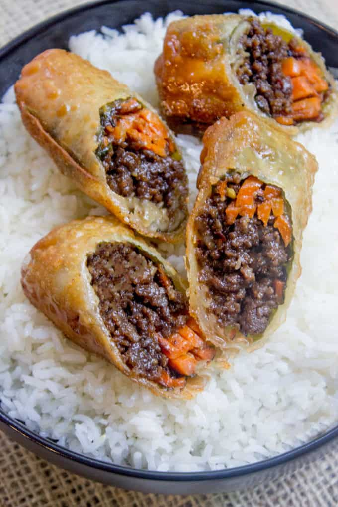 Korean Ground Beef Egg Rolls with carrots and served over rice