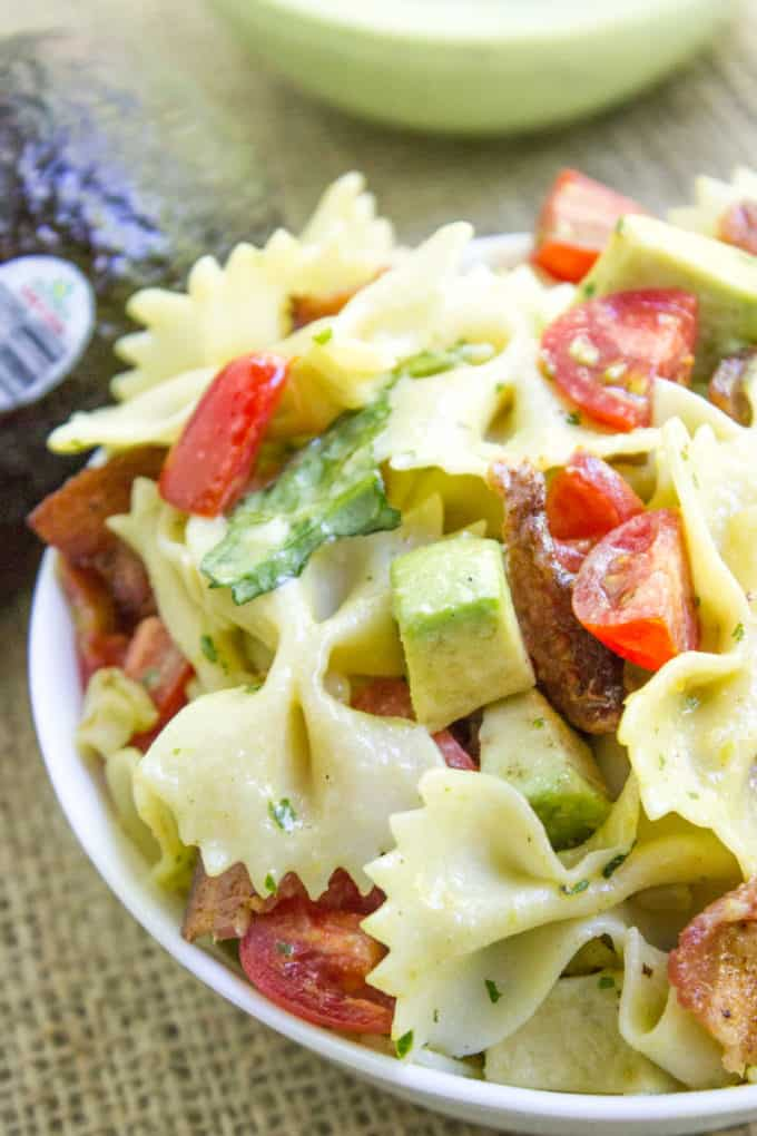 Avocado BLT Pasta Salad with avocados blended into a cilantro lime dressing and chunks for a delicious creamy bite with bacon, lettuce and tomatoes.