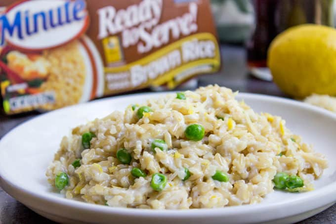 One Minute Brown Rice Risotto with garlic, peas and lemon makes the perfect on the go meal that feels like you spent all day in the kitchen in just one minute in the microwave.