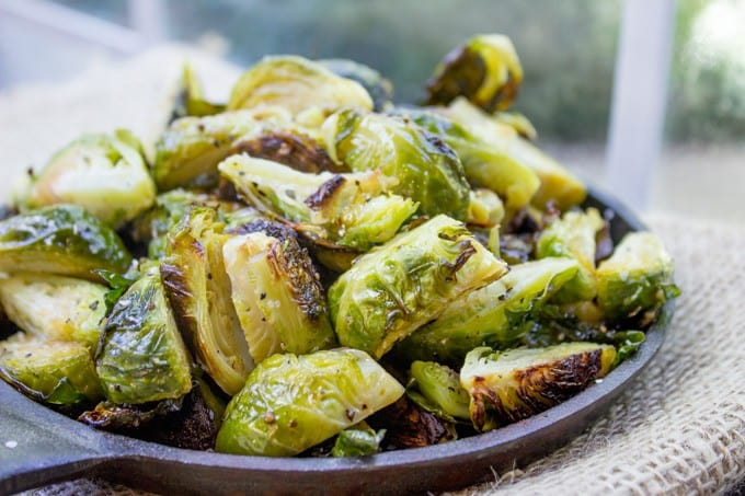 Oven Roasted Brussels Sprouts are an easy side dish for your favorite weeknight meal and they're delicious enough that everyone will be fighting over the last helping.