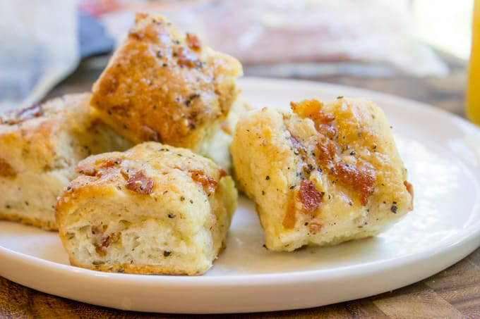 Black Pepper Bacon Biscuits are peppery, full of delicious bacon, cream cheese and buttermilk, they are fluffy and flaky. The perfect biscuit for your weekend brunch!