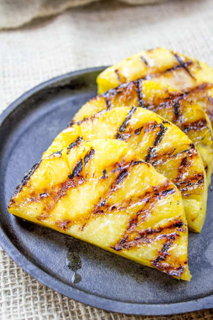 How to Grill Pineapple - grilled pineapple slices on plate