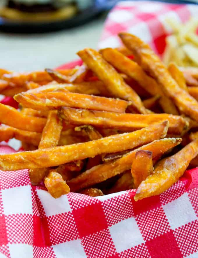 Crispy Sweet Potato Fries with a single magic ingredient to keep them crispy! No more soggy fries, these stay crispy even if you have to reheat in the oven.