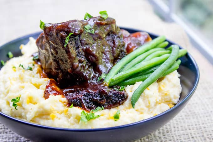braised short ribs served with green beans and potatoes
