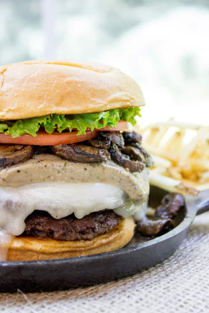 Truffle Mousse Burgers made at home with delicious truffle mousse, mushrooms and pepper crusted beef patties, this is the perfect indulgent burger for your summer cookout, graduation or Father's Day.