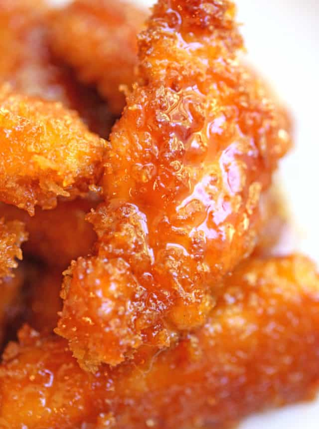 Chicken Fire Poppers are panko crusted, skillet fried then dipped in the most glorious honey-brown sugar hot sauce you've ever tasted and baked until they are bites of crunchy, sticky, sweet, spicy perfection!