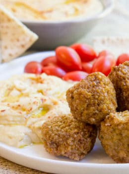 Classic Falafel made with dried chickpeas and tahini, this traditional falafel is exactly what you's have at your favorite Middle Eastern restaurant. Not a single canned chickpea in sight, so no mushy texture!