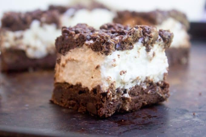 Marshmallow Crunch Brownie Bars are a totally indulgent brownie with three kinds of chocolate, an awesome marshmallow layer and the best brownie base.
