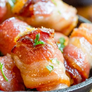 Bacon Wrapped Tater Tot Bombs are an easy appetizer of tater tots and sharp cheddar cheese wrapped in thick cut bacon, rolled in brown sugar and baked.
