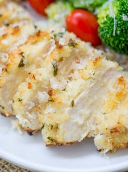 Crispy Baked Lemon Parmesan Chicken with fresh lemon, butter, garlic and Parmesan has all the flavors of your favorite scampi dish but in a healthier oven baked version.