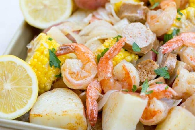 Closeup of shrimp boil with corn, shrimp sausage and potatoes