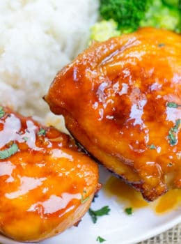 Baked Fire Popper Chicken is made with chicken breasts baked in a glorious honey-brown sugar hot sauce until they're sticky, sweet, spicy perfection!