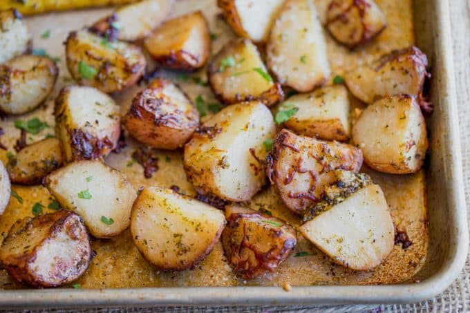 Parmesan Pesto Roasted Potatoes are ready for roasting in minutes with red potatoes, basil pesto, olive oil and Parmesan Cheese.