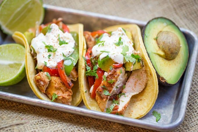 crockpot chicken fajitas served with limes and avocado