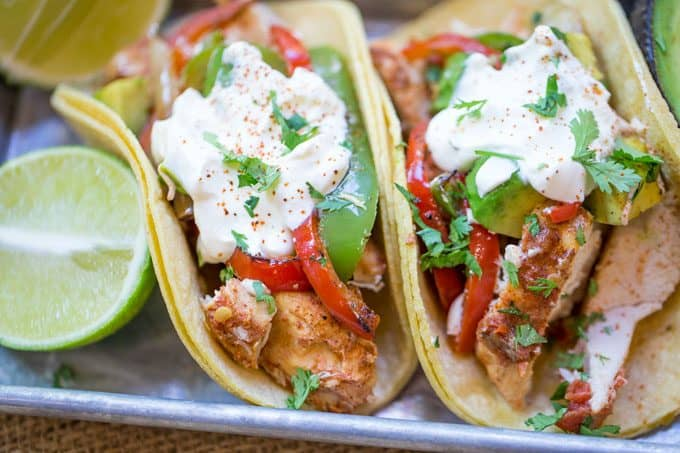 slow cooker chicken fajitas in tortillas served with lime