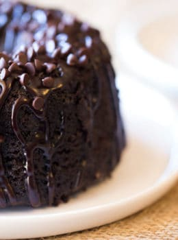 Triple Chocolate Bundt Cake with the richest chocolate cake made from scratch and covered in a dark chocolate ganache and extra chocolate chips.
