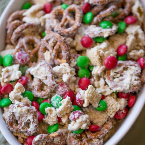 Christmas White Chocolate Trash Snack Mix with pretzels, cereal, peanuts and chocolate coated candies all tossed together with a generous coating of white chocolate.