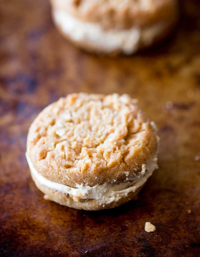 Peanut Butter Do-si-dos Cookie Sandwiches are a Girl Scouts favorite made with peanut butter and oatmeal are sandwiched together with a fluffy soft peanut butter buttercream filling.