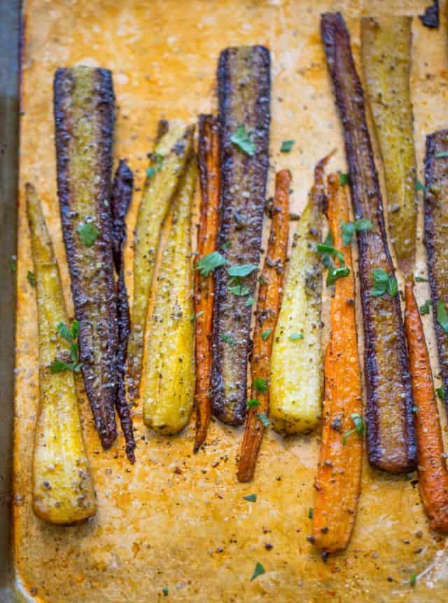 Garlic Butter Roasted Carrots with a touch of canola oil, cracked black pepper and Kosher salt makes the perfect side dish for a weeknight meal or a holiday crowd.