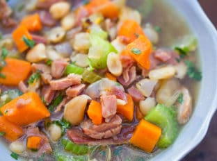 Slow Cooker Ham and White Bean Soup is the perfect recipe after your holiday ham when you want a cozy warm soup to help you recover from holiday cooking!
