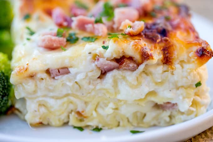 Chicken Cordon Bleu Lasagna made with Ham, Chicken, Swiss and Mozzarella cheeses is the perfect comforting meal to make with your leftover holiday hams!