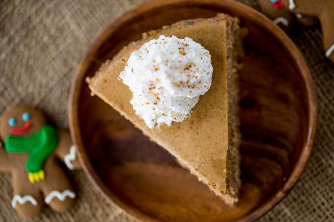 Gingerbread Cheesecake is creamy and tangy and full of warm holiday flavors that is the perfect ending to your favorite holiday meal.