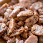 Slow Cooker Candied Cinnamon Pecans are a total breeze to make and will leave your house smelling absolutely delicious! Plus they double as amazing holiday gifts you can make in bulk!
