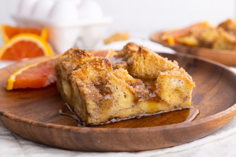 Easy French Toast Bake on wood plate with orange slice