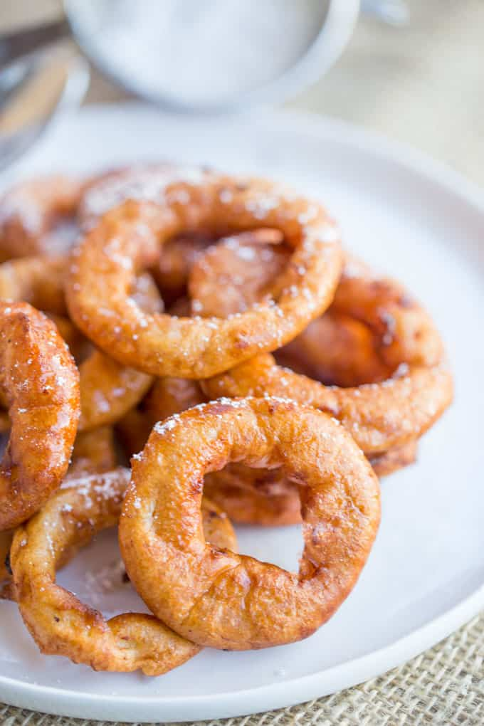Apple Fritter Rings made with a pancake batter without yeast come together in just a few minutes and are the perfect sweet treat to end a meal or breakfast for kids who love donuts.