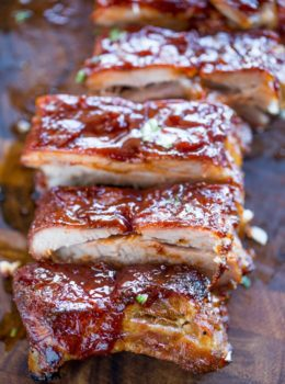 Slow Cooker Barbecue Ribs that are fall off the bone tender made with a homemade rub and easy tangy bbq sauce. These are perfect for your summer barbecues!