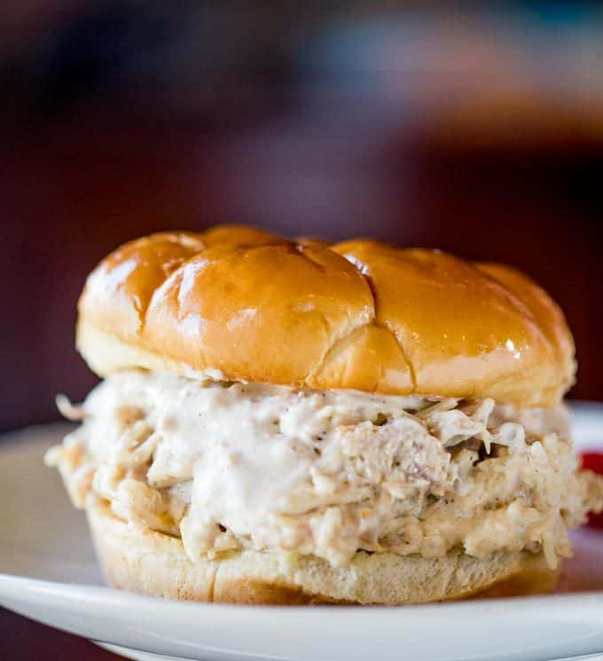 Slow Cooker Chicken Caesar Sandwiches made with easy homemade caesar dressing, Parmesan Cheese and a buttery hamburger bun.