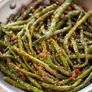 Spicy Sichuan Green Beans are the perfect easy side dish to your favorite Chinese meal and they're a breeze to make with just a few ingredients.