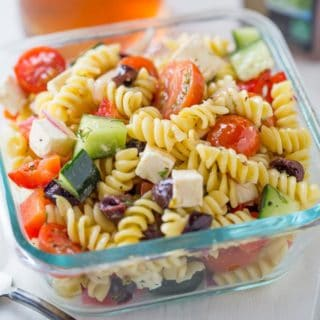 Easy Greek Pasta Salad with a homemade vinaigrette, pasta, feta, and olives is the perfect, easy lunch meal you can enjoy at room temperature. Also great with added chicken or shrimp.