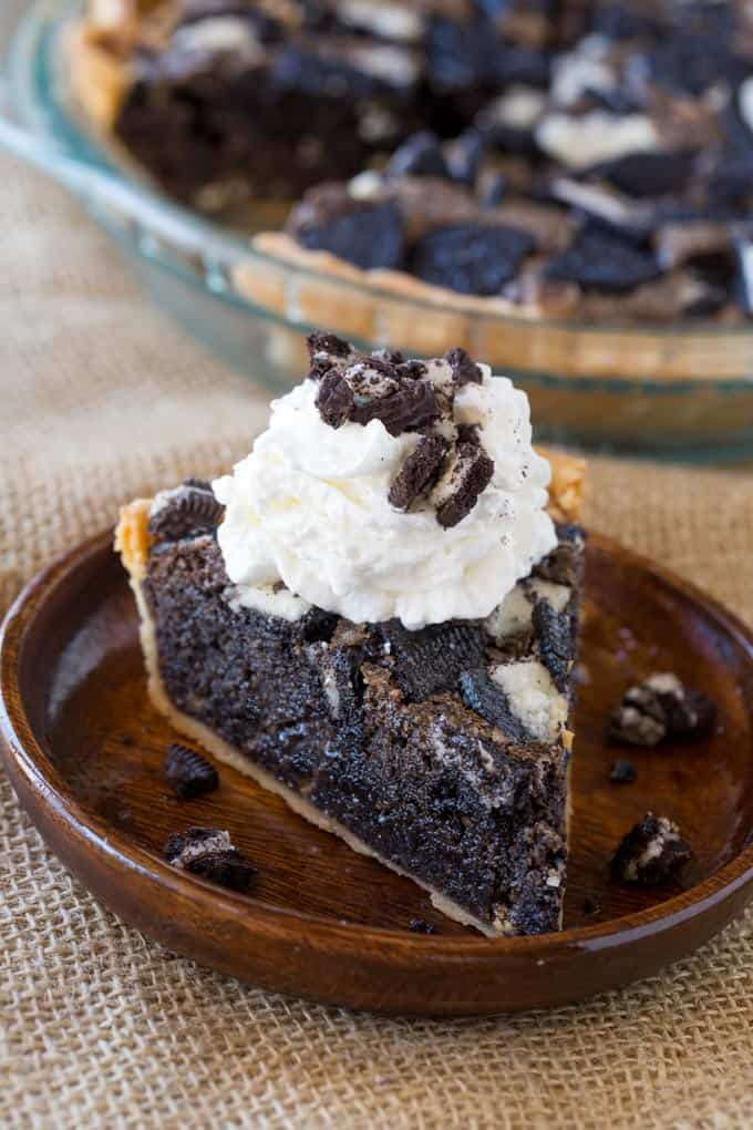 Oreo Chunk Cookie Pie tastes like a delicious, warm, Oreo chunk cookie baked into a buttery crisp pie crust that's half pie and half fresh baked cookie!