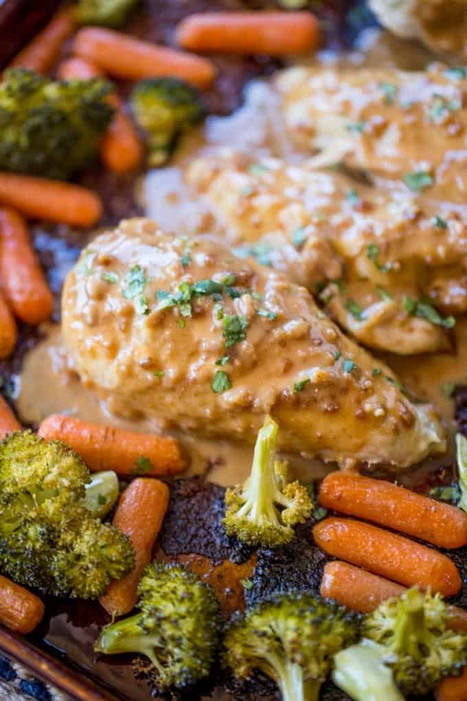 Sheet Pan Peanut Chicken and Vegetables is an easy, but authentic weeknight dinner with almost no cleanup! Serve with rice or noodles.
