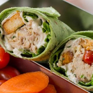 Slow Cooker Chicken Caesar Salad Wraps with shredded chicken, an easy anchovy free caesar dressing, croutons, tomatoes and Parmesan cheese in a spinach tortilla. Perfect for your lunchbox!