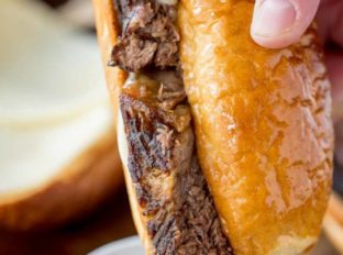 Slow Cooker French Dip Sandwiches are the ultimate sandwich made with your favorite beer with thick slices that are super tender with an amazing crust.