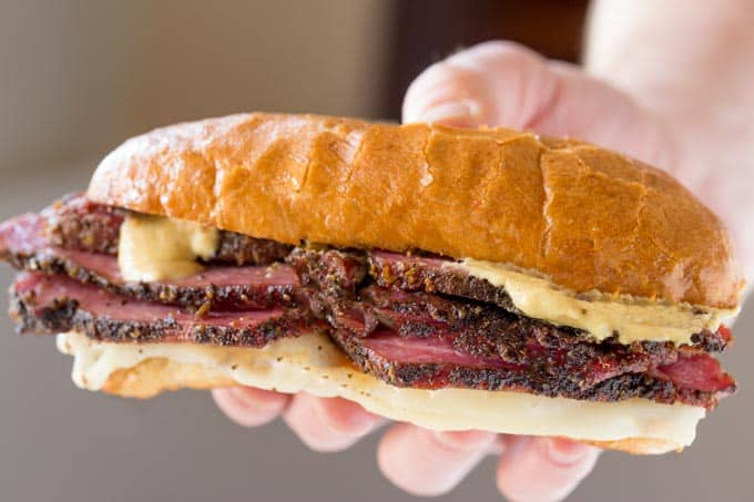 Slow Cooker Pastrami Sandwiches are easy to make for a crowd or for your lunches and takes just a few ingredients. You'll never buy deli pastrami again!