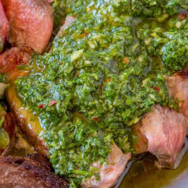 Chimichurri Sauce is an addicting, crazy easy marinade and sauce you'll enjoy all summer long that is the perfect topping (and marinade) to all things grilled.