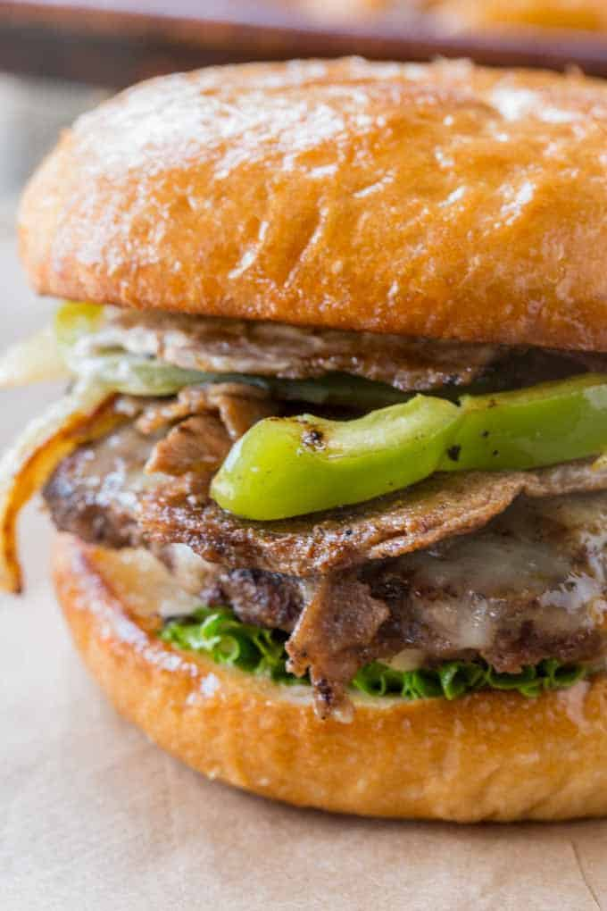Philly Cheese Steak Burgers made with thinly sliced ribeye and veggies.