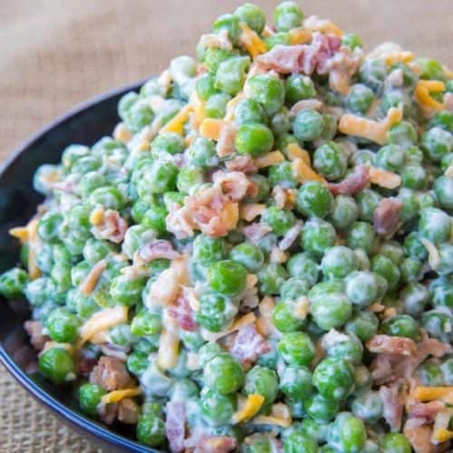 Creamy Bacon Pea Salad with mayonnaise, bacon, cheddar cheese and crunch peas. The perfect southern summer side dish!
